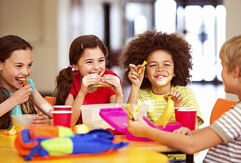getty_rf_photo_of_school_children_eating_lunch